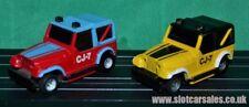 Par De Tyco CJ 7 jeeps con luces de trabajo sobre autos iluminados curva Hugger HO Slot