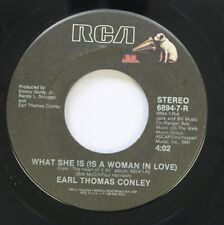 Country 45 Earl Thomas Conley - What She Is (Is A Woman In Love) / Carol On Rca