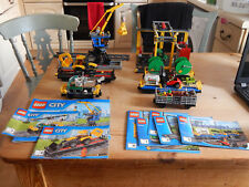 LEGO cargo wagons and goods/crane stations from both train 60098 and 60052 sets