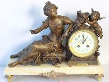 Pendule en régule sur marbre décor de femme et putto Moreau clock