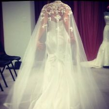 The ultimate dramatic cape bridal gown by Impressions bridal 2015 collection.