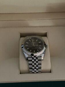 BRAND NEW Rolex Datejust 41 Steel Smooth Bezel Rhodium Dial Watch. Ideal Bezel