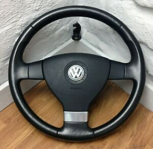 Genuine VW black leather steering wheel, with centre. Fits T5, 2003-2009.    A16
