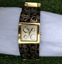 Guess Ladies Watch with Champagne Dial, Dark Animal Bracelet Gold