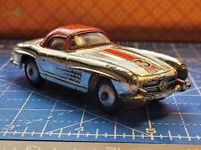 Corgi Toys, Mercedes-Benz 300 S L Roadster.(304 S)1960's Flat Silver Spun Hubs.