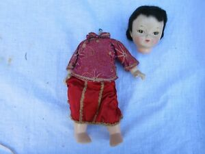 VINTAGE PRETTY CHINESE DOLL NEEDS STRINGING  AS IS