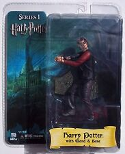 HARRY POTTER ACTION FIGURE. FROM NECA. SERIES 1. WITH WAND & BASE. 7 INCHES. NOC
