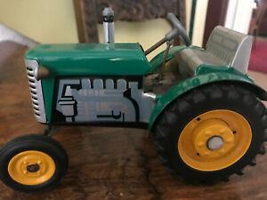 metallspielzeug, Traktor mit Hänger, zum Aufziehen