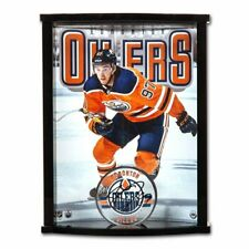 Connor McDavid Autographed Oilers Acrylic Puck with Oilers Picture Curve Display