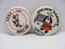 2 Hockey Buttons-C.O.H.A. Labatts World Cup-Golden Garden Old Timers Simcoe