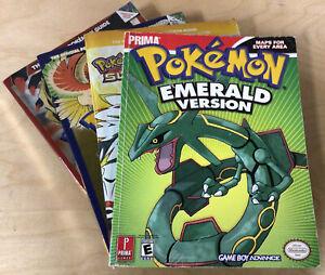Lot of 4 Pokemon Game Guides - Emerald, Sun/Moon, Platinum, HeartGold/SoulSilver