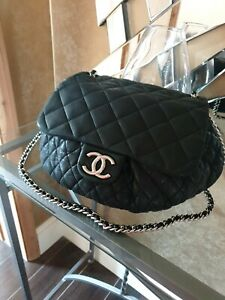 Authentic CHANEL.Large Chain-Around Crossbody Quilted Bag.  Dark Grey. Used.