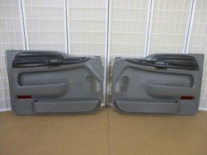 99-07 Ford F250 F350 Pickup or Excursion LEFT & RIGHT GRAY Power Door Panel Set
