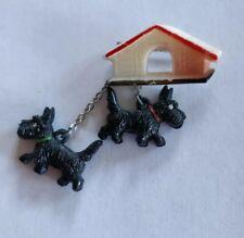 Art Deco celluloid westie dogs brooch