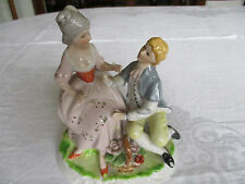 Vintage figurine of courting couple