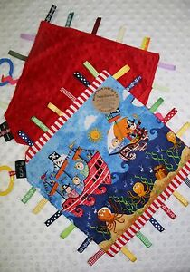 Taggie Blanket pirate boats with red dimple minky backing