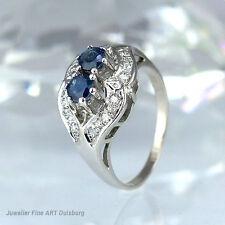 Ring in 585/- Weißgold mit 2 Saphiren 0,40 ct., 12 Diamanten ca. 0,12 ct. W/VSI