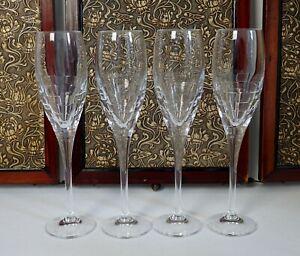 Set of four Edinburgh Crystal Skibo pattern champagne flutes / glasses