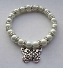 White Glass Pearl & Diamante Elastic Bracelet / Tibetan Silver Butterfly Charm