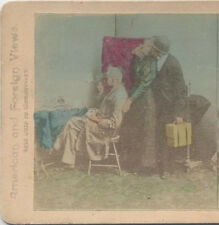 STEREOVIEW,  IMAGE OF A MAN WITH A BOX CAMERA, AND A MAN WITH A STEREO VIEWER.