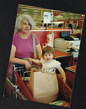 Old Vintage Photograph Little Girl Sitting in Cart Grocery Shopping w/ Grandma