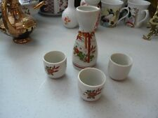Lovely Little Saki or Plum Wine Bottle with three little cups
