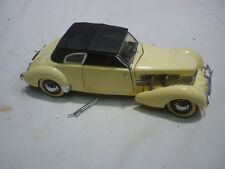 A Franklin mint scale model car of a 1937 Cord  812 convertible Phaeton, no box