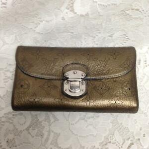 Auhtentic Louis Vuitton Gold Amelia Tri-fold Wallet 7.5in x 4.5in