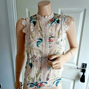 Bohemian style floral blouse with feature embroidery size small creams & multi