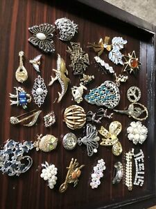 large lot of vintage rhinestone brooch is for repair. some signed.