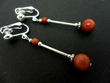 A PAIR OF DANGLY GOLDSTONE  BEAD  SILVER PLATED DROP CLIP ON EARRINGS.