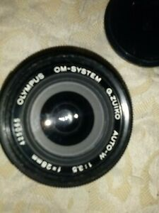Olympus om system 28mm mint condition with case f3.5 auto-w