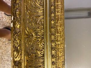 antique gold carved wood mirror