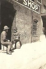 WWI Original US Army RP- Two Soldiers- Uniform- Hat- Sit on Barrels by a Shop
