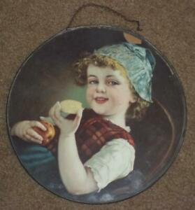 """ANTIQUE FLUE HOLE COVER, GIRL WITH COOKIE & APPLE, 9 1/2"""", DAMAGE TO FRAME"""