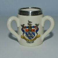 Antique crested ware Torquay three handled loving cup with silver rim, 1913