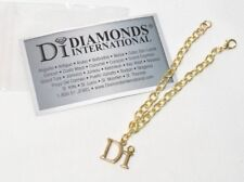 "NEW in Package Diamonds International Gold Tone Di Cruise 7.5"" Charm Bracelet"