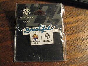 Nu Skin Olympics Pin - 2002 Salt Lake City Utah Winter Olympics Lapel Hat Pin