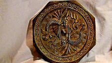 "ARCHAIC CHINESE EIGHT-SIDED BRONZE MIRROR WITH EMBOSSED WINGED ""TWIN DRAGONS"""