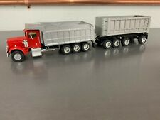 A Smith Auto Models 1:50 Peterbilt 3 Axle Dump Truck w/ Spread Axle Pup Trailer