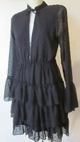 Boohoo black spot frilly feminine dress with sheer sleeves.Fully lined Size 12