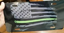 Black and Gray Thin Green Line Tattered American flag car tag license plate