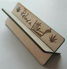 Wooden rolling up stand with slogan on  'Relax a little'