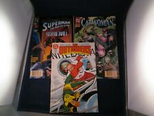 Lot of 3 Vintage DC Comics Catwoman, Superman, and The Outsiders Comic Books