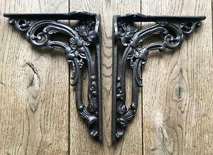 A pair of cast iron Victorian style foliage shelf brackets shelving cistern