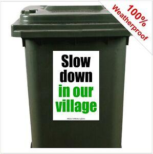 Slow down in our village road safety wheelie bin sticker sign 9424 30 x 20cm
