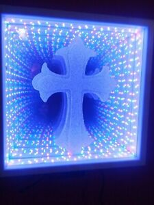Infinity Mirror with color changing LEDs and 44 key wireless remote.with cross
