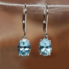 14k White Gold Diamond and Blue Topaz Oval Dangle Earrings