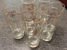 Seven Drinking Glasses with Holly Tree Swag and Gold Rim