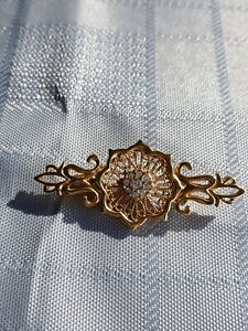 Gold Tone Broach With Clear Stone